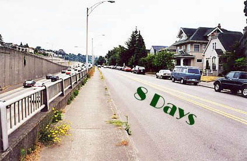 """""""8 days,"""" painted on street"""